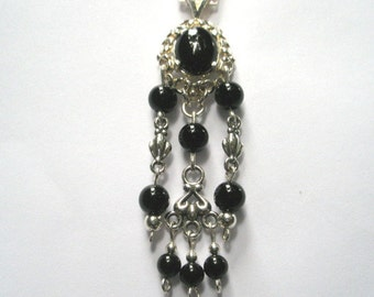 sterling silver pendant with onyx cabochon and beads