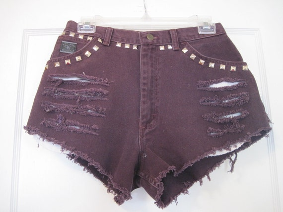 AWSOME  denim cut off shorts size 8 waist 29 inches frayed ripped with studs added plum color