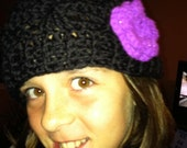 Crochet hat with purple flower, ready to be made in any size