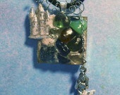 Necklace_SEA GLASS with MERMAID and sandy Castle! Mermaid dangles free from a fine chain just below the sandy path up to her castle! 19.00