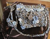Flowered bag with purse. This is a one of a kind item.