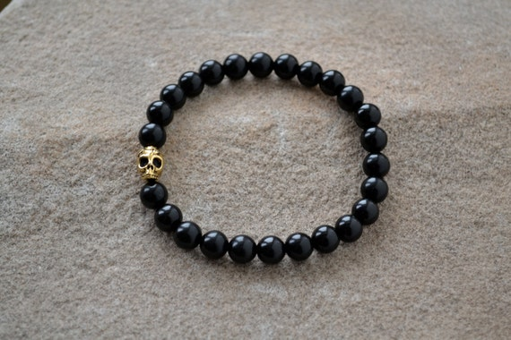 Black Onyx with a Gold Day of the Dead Skull Beaded Bracelet