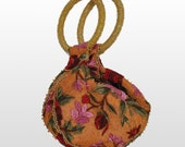 Orange  Bag with embroidery and a wristlet