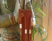 Leather Fringed  Medicine Bag with Carved Bone Beads. crystal bag, boho, urban cowgirl, gypsy, treasure bag.