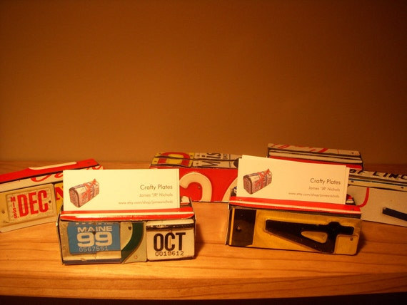 A pair of Business Card Holders made with recycled license plates.