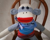 Blue Denim Classic Red Heel Sock Monkey Boy Doll In Argyle Sweater