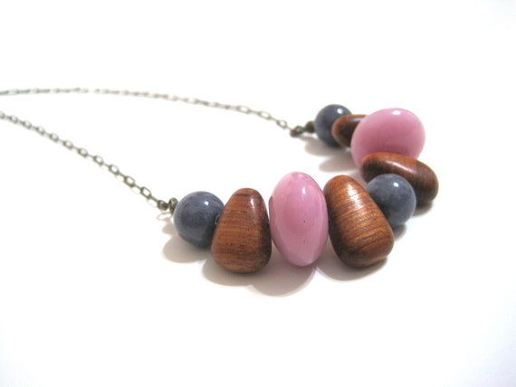 beaded tribal necklace. geometric. pink. wood. stone.