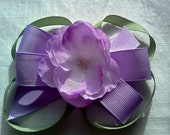 purple hair bow with purple and white flower and green loops womens girls toddlers and babies