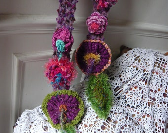 hand made crochet colourful scarf with flowers and green leaves inspired by nature vegetal art violet pink green