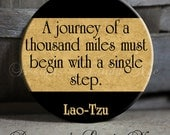 "Exclusive - A journey of a thousand miles must begin with a single step. Lao-Tzu Black Tan Brown - 1.5"" Pinback Button"