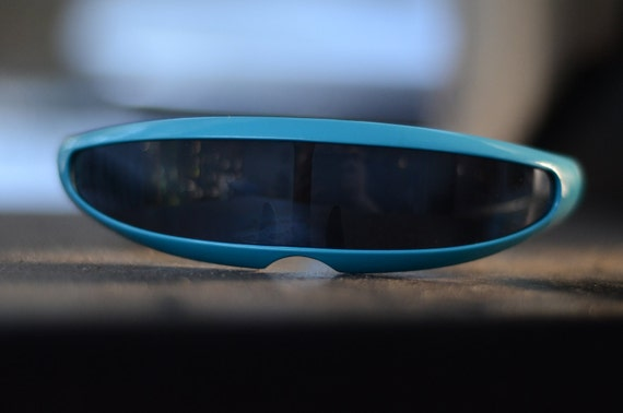 RESERVED FOR Meljoree Padua's. We are not men we are Devo blue Cyclops shades.