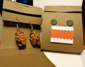 Peace Domo earrings in a Domo matchbook cover