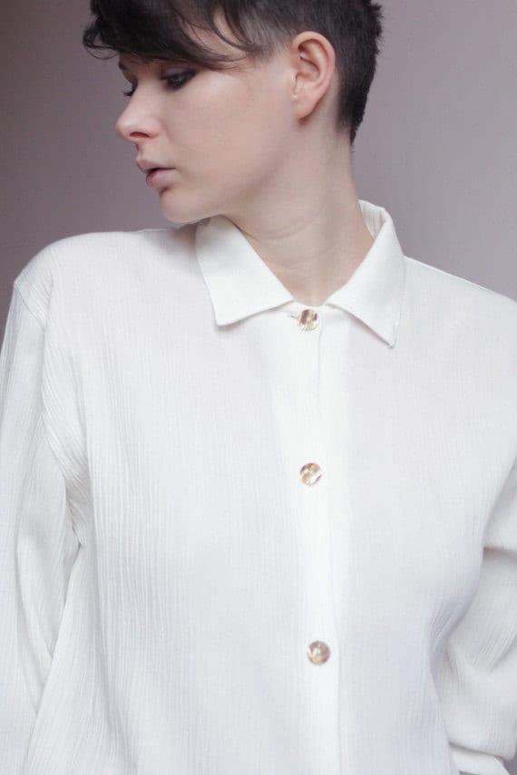 Long white blocks blouse