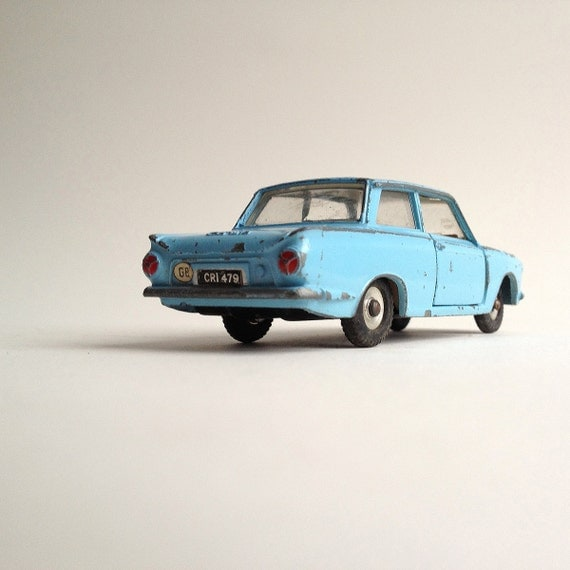 A vintage sky blue Dinky Ford Cortina, 1963/4 with opening doors and tipping seat backs