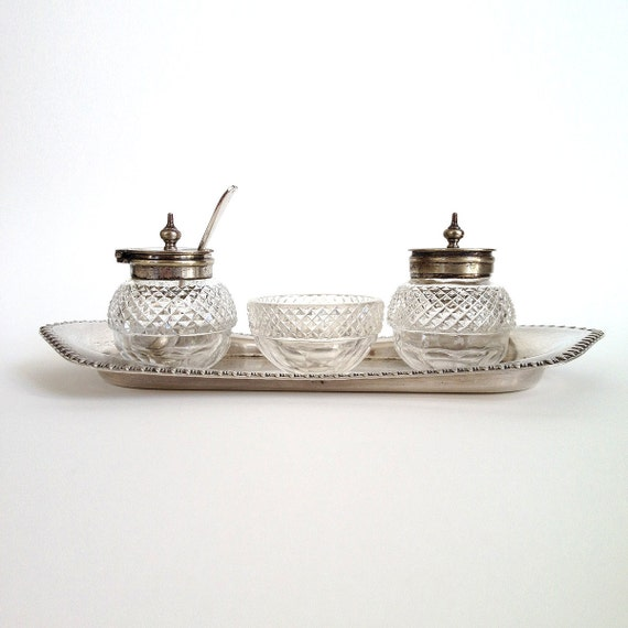 A dainty vintage glass and silver tone cruet set...tray, salt bowl, pepper and mustard pots and little spoon