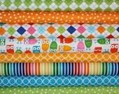 orange, green, and aqua gender neutral 5-piece bedding