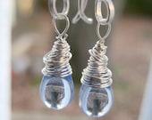 Wire wrapped silver plated earrings with light blue czech glass teardrop