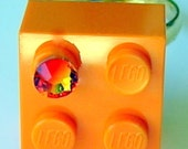 Orange LEGO (R) brick 2x2 with an Orange SWAROVSKI crystal on a Silver/Gold plated adjustable ring finding