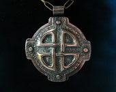 copper repousse celtic knot pendant.