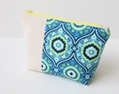 "Zippered Cosmetic Pouch in Blue Green Yellow Natural, ""Lark"" designer fabric"