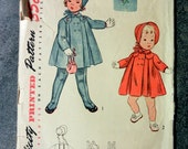 Sweet vintage sewing pattern Simplicity 3698 for little girl's coat, bonnet, and leggings