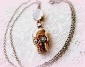 Moonstone and gold rhinestone skull pendant