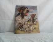 Tin sign of  Hound dog and her puppies signed by artist