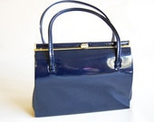 Vintage 60's navy blue patent kelly bag with suede lining