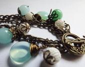 Aqua Blue Seafoam Green Antique Brass Opal Glass Charm Bracelet