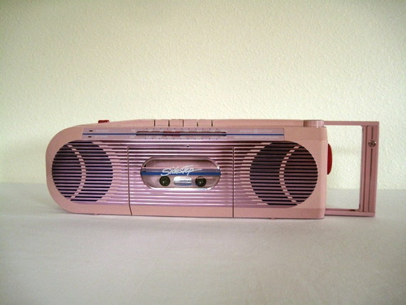Pink Sidestep cassette player with earphones and radio-perfect condition