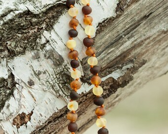 Raw colored amber teething necklace. Maximum pain relief
