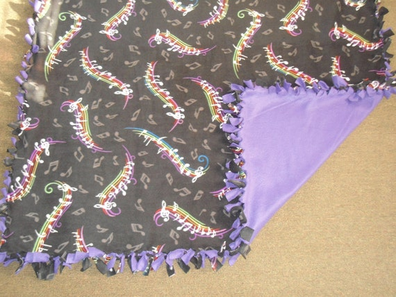 """Medium/Large Musical Fleece no sew blanket with a purple back, 54"""" x 58"""" 1.5 yards"""