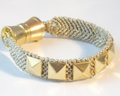 Studded hand knotted gold friendship bracelet with gold bow clasp