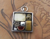 small mosaic pendant with neutrals, shell, ceramic, bronze flower