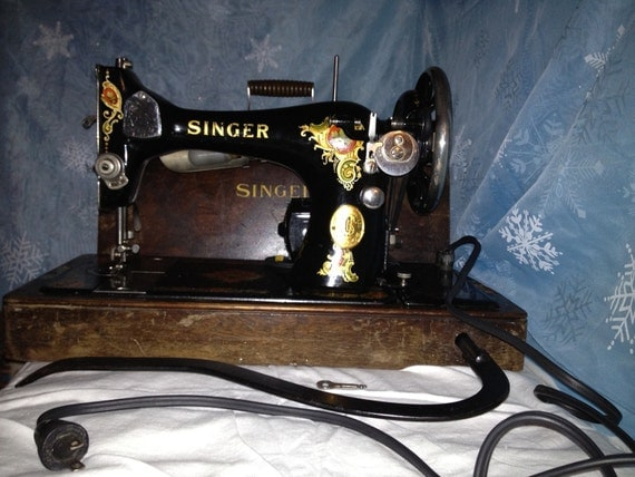 Singer Sewing Machine 128, bent wood case.