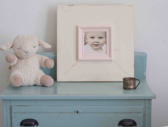 distressed handmade cream picture frame with pink trim