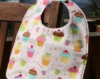 TODDLER or NEWBORN Bib: Tossed Cupcakes on Light Pink, Personalization Available