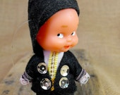 Tiny rubber doll with traditional spanish clothes. So cute little boy