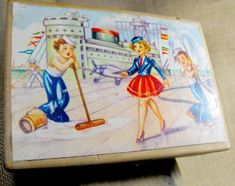 Customized old wood box with port scene. Two boys and a sailor lady. Very cute