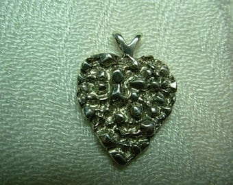 "Sterling silver pendant ""goose bump"" heart design."