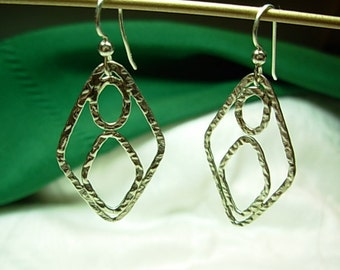 Sterling silver ( .925 ) dangling earrings.