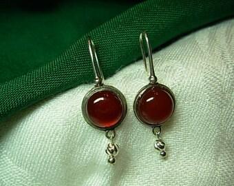 Sterling silver ( .925 ) earrings.  Carnelian cabochon stones.
