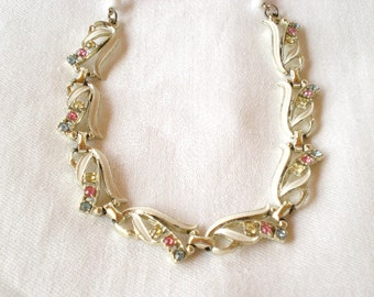 VINTAGE 1950s flowers necklace with white enamel paint and pastel rhinestones, and milk glass bead, gold tones... great for a wedding