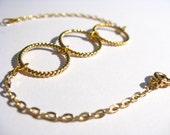Delicate triple gold loop bracelet