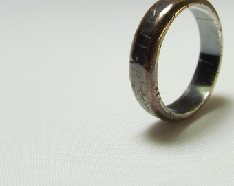 Men's wedding ring in copper with a sterling lining