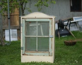 Small tomato or apartment Greenhouse with reclaimed windows