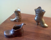 Three vintage solid brass boot collectibles