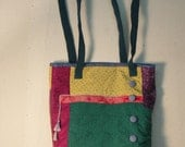 Pieced and quilted tote with tassle and button embellishments