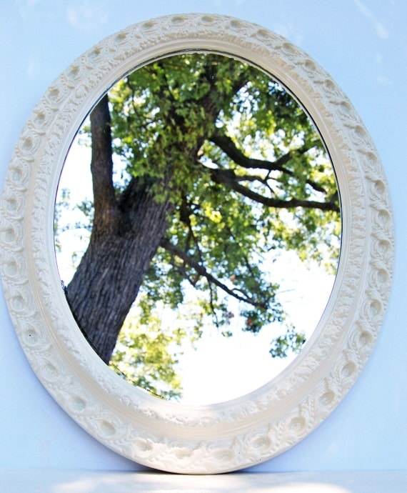 Vintage Ornate Mirror with Aged Frame