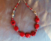 Chunky red coral necklace with fluted silver beads and crystals